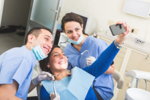 happy patient taking selfie at the dentist