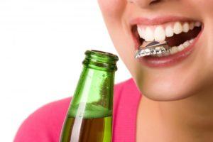 teeth open bottle