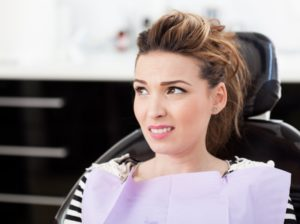 woman asks do teeth cleanings hurt
